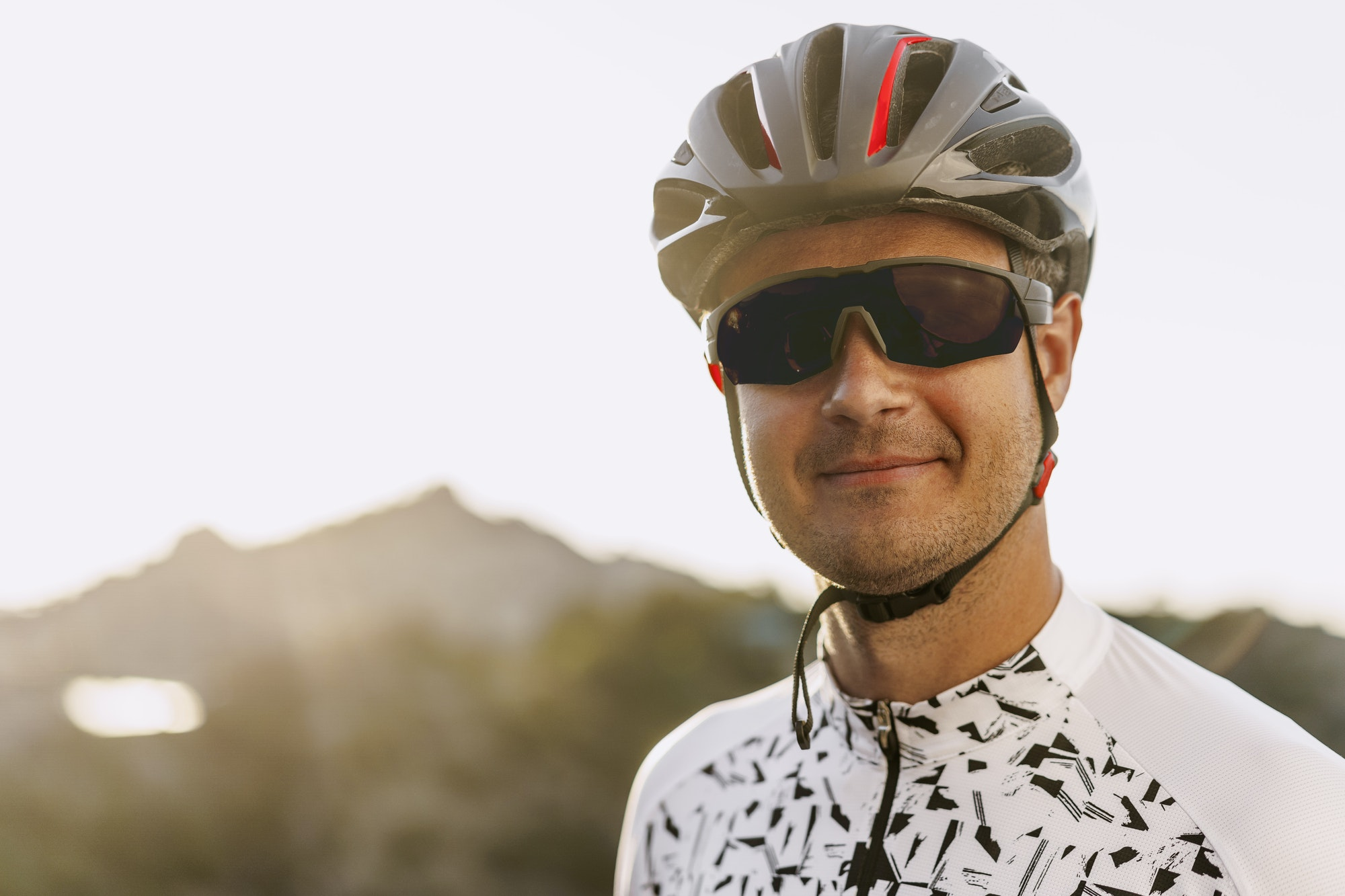 Portrait of male caucasian cyclist with helmet and glasses